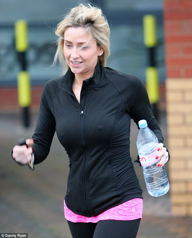 Ready for action: The Hollyoaks actress seemed to be in good spirits as she arrived at her local gym in Liverpool, showcasing her naturally flawless skin by going make-up free as she made her way inside
